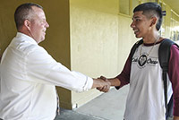 A Fresno Unified staff member welcomes a student on the first day of school